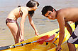 Couple Pulling Their Kayak Out Of The Water stock photography