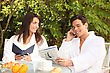 Patio Couple Reading Over An Outdoor Breakfast stock photography