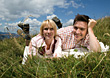 Couple Resting In The Grass stock photo