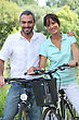 Biking Couple Riding Bikes stock photo