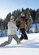Couple Running Thru Snow stock photography