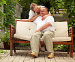 Seniors Couple Seniors In House Garden stock photo