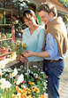 Couple Shopping For Flowers Outside stock photo