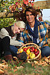Couple Taking A Break From Picking Apples stock photo