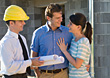 Couple Talking With Home Builder stock photography