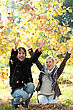 Couple Throwing Leaves In The Air stock photo