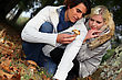 Couple Watching A Mushroom In Forest stock photography