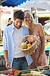 Pickup Couple With A Basket At Market stock photography