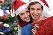 Couple With A Christmas Gift stock photo