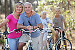 Couples Riding Their Bikes Together stock photography