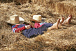 Cowboys Sleeping in the Hay stock photo
