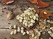 Cracked And Dried Pistachio Nuts In A Wooden Bowl stock photo