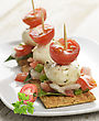 Crackers With Mozzarella Cheese And Tomatoes stock image