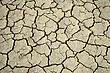Cracks In The Parched Earth Of The Steppe. stock photo