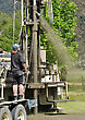 Crew Working A Drilling Rig In The Search For Bore Water, Westland stock image