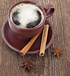 Cup Of Coffee With Cinnamon On The Wooden Background stock photography
