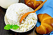 Curd In A Bowl With Basil, Wooden Spoon, A Bagel, A Jug Of Milk, A Napkin On A Wooden Board