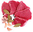 Cut Of Beef Steak With Garlic Slice, Onion And Laurel. Isolated