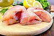 Cut Pieces Of Red Grouper, Dill, Lemon, A Bottle Of Vegetable Oil, A Napkin On A Wooden Board stock photo