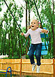 Playful Cute Cheerful Little Girl Is Swinging On Swing stock photo