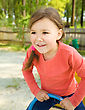Cute And Happy Little Girl Is Swinging On See-saw