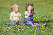 Cute kids at the spring field stock image