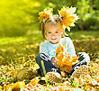 Cute Little Girl In Autumn Park Holding Bunch Of Yellow Leaves stock image