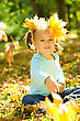 Outing Cute Little Girl In Autumn Park Throwing Bunch Of Yellow Leaves stock photo