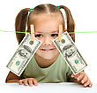 Playful Cute Little Girl Is Playing With Paper Money - Dollars stock photo