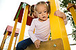 Cute Little Girl Is Playing In Playground stock image