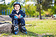 Cute Little Skater Boy Sitting On The Stone In The Park stock photography