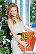 Cute Young Woman With A Christmas Present In The Orange Box