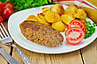 Cutlet Meat With Roasted Potatoes, Tomatoes And Dill On A Plate, Parsley, Napkin On Wooden Board