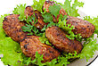 Cutlets On Salad Leaves stock photography