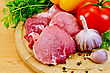 Cuts Of Meat, Garlic, Tomato, Pepper Pots Of Different, Parsley And Dill On A Wooden Board stock photo