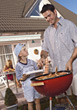 Dad and Son Barbequing stock image