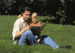 Dad Reading to Son stock photo