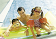 Dad with Kids in Pool stock photography