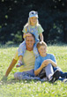 Dad with Kids in the Park stock photo