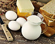 Dairy Products And Fresh Eggs On A Old Wooden Table stock photo