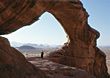 Desert Bedouin Under Rock Arch, Jordan stock photo