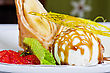 Dessert Of Pancake With Banana, Ice-cream, Caramel, Strawberry And Mint stock image