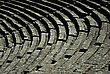 Columns Detail Of Seats At Ancient Greek Amphitheater Of Epidaurus At Sunny Summer Day. stock photo