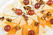 Different Cheese And Grapes Close Up Composition stock photography