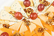 Different Cheese And Grapes Close Up Composition