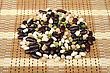 Different Pile Of Beans On The Mat stock photo