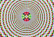 Digital Abstract Image With An Explosion Of Blue Red Yellow Green And Purple Producing An Optical Illusion Of Movement