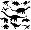Dinosaur Silhouettes Against White Background