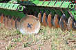 Disc Harrow Behind Tractor Turning The Soil stock photo