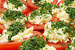 Dish Of Red Tomato Slices With Horseradish And Chopped Parsley stock photography